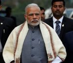 FILE PHOTO - Prime Minister Narendra Modi walks to speak with t
